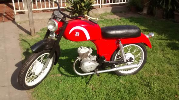Moto Paperino Dec100